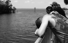 I wanna go home!!! (Twila1313) Tags: teenager boy bored boredom fishing family river pier dock peaceriver streetphotography candid monochrome blackandwhite blackwhite sonya7ii