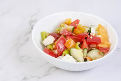 Greek Salad in the bowl above grey marble table (wuestenigel) Tags: red food green closeup cheese breakfast dinner tomato table lunch pepper greek cuisine leaf salad healthy dish eating background cucumber olive tasty plate bowl vegetable fresh delicious lettuce snack meal vegetarian served onion appetizer diet popular feta nutrition ingredient antioxidant
