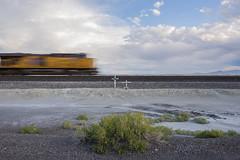 Desert Train (JasonCameron) Tags: utah west desert wander sunset light train motion blur running cross death brush