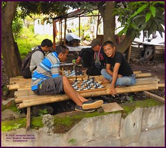Cirebon Java Chess 20190328_110849 DSCN4238 (CanadaGood) Tags: people color colour building indonesia person java asia seasia westjava indonesian asean cirebon javanese 2019 canadagood thisdecade tree chess smoking