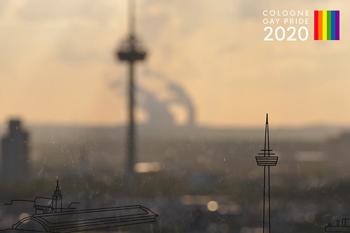 Blurry background image of the city, next to picture title Cologne Gay Pride 2020, to celebrate LGBTQ und diversity