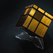 Golden cube puzzle on black background