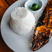 Close up shot of grilled bangus with rice