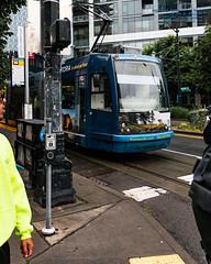 The @KenmoreAir Streetcar at the Light (AvgeekJoe) Tags: d7500 dslr kingcounty nikon nikond7500 seattle seattlestreetcar southlakeunionline southlakeuniontrolley usa washington washingtonstate masstransit publictransit publictransportation streetcar tram urbanrail