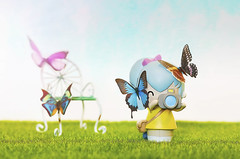 pixie loves butterflies (rockinmonique) Tags: pixie momiji doll chair butterfly mini miniature toy cute pretty whimsical yellow green blue pink moniquewphotography canon canont6s tamron tamron45mm copyright2019moniquewphotography