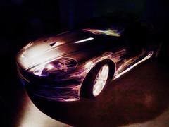 Coming Into the Light (Steve Taylor (Photography)) Tags: digitalart museum brown black blue mauve purple uk gb england greatbritain unitedkingdom london texture car astonmartindbsv12 bondinmotionjamesbondexhibition jamesbond londonfilmmuseum quantumofsolace