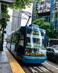 Seattle Streetcar Coming to A Station in Kenmore Air Livery (AvgeekJoe) Tags: d7500 dslr kingcounty nikon nikond7500 seattle seattlestreetcar southlakeunionline southlakeuniontrolley usa washington washingtonstate masstransit publictransit publictransportation streetcar tram urbanrail