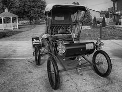 In my Merry Oldsmobile (kendoman26) Tags: hmm happymonochromemonday july2019morrisilcruisenight monochrome blackandwhite 1904oldsmobile sonyalpha sonya6000 selp1650 hdr nikhdrefexpro2 niksilverefexpro2