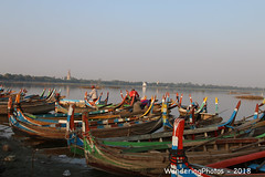 Boats waiting for the tourists - U Bein Bridge Taungmyo Lake Amarapura Mandalay Myanmar (WanderingPJB) Tags: accumulation flickruploaded myanmar burma mandalay buddhism ubeinbridge taungmyolake amarapura