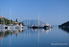 Morning in the harbour (stewardsonjp1) Tags: vathy peaceful sea clear blue meganissi ionianislands morning dawn boat refkections water harbour greece