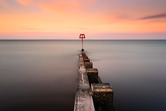 Glory (Pete Rowbottom, Wigan, UK) Tags: swanage groyne pier sea jetty sunset colourfulsunset longexposure longexposurelandscape seascape clouds uk england jurassic coast minimal peterowbottom woodengroyne art beauty red yellow summer warmth nisifilters nisiambassador fotoprotripod fotoproambassador cloudmovement surreal dorset beach 2019 purbeck isleofpurbeck isleofwight ndfilter vivid