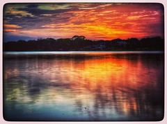 Sunset on the Lake (twilitize) Tags: sunset sun sunsets florida clouds lake water pop popular landscapes floridascapes fireyskies skies