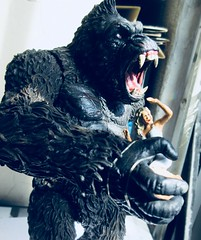 King Kong on Rampage with Fay Wray type 5416 (Brechtbug) Tags: king kong gorilla mezco toy monster portrait plastic walking spitting sparks creature rko empire state building new york city july 07142019 nyc 2019 shelf toys action figure wild shadow shadows gorillas fay wray type heroine