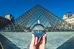 Famous Louvre Museum Pyramid through the crystal ball, Paris, France (A. Aleksandravičius) Tags: louvre museum paris france architecture art pyramid luvre modern glass tourism beautiful design night famous monument people sky travel building city culture construction structure europe place destination french facade palace historic blue pyramide abstract pattern symbol october crystalball glassball hand bodyparts holding