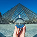 Famous Louvre Museum Pyramid through the crystal ball, Paris, France
