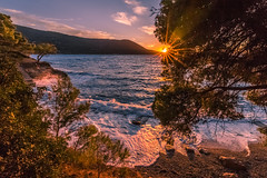 Wavy sea at sunset (Vagelis Pikoulas) Tags: waves sea seascape landscape porto germeno greece tokina 1628mm canon 6d beach sun sunset sunburst nature