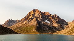 Tuviligssuaq, Greenland (CanonDLee) Tags: angiartarfik atlantic christian direction evening fjord golden goldenhour greenland hour ice iceberg lateafternoon light mountain mountains north prince princechristiansound prinschristiansund qalutaussuaq rock rocks saltwater september sky snow sound southernhemisphere sund tuviligssuaq warm water