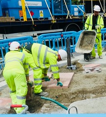 Tapping a paving stone (gerrypopplestone) Tags: gas workers construction manual repairs digging chancerylane