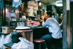 Alleyway yakitori stall (Jon Siegel) Tags: nikon nikkor 35mm f14 nikon35mmf14ais 14 d810 people shinjuku tokyo japan japanese life dining afternoon city urban yakitori