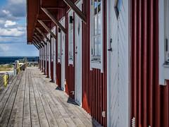 Day dreaming (katrin glaesmann) Tags: sweden holidays boardwalk woodenpier steg boathouses hörvik listerland blekinge sea woodenhut redhut harbour