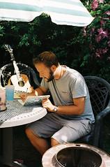 Songwriting... (Warm Seas) Tags: babytaylor guitar babytaylorguitar songwriter singer songwriting sussex summer july garden 35mm filmphotography pentaxmesuper kodakgold200 omega seamaster quartz dynamic omegaseamaster omegaseamasterquartzdynamic clematis purple nickkosmusic omegaseamasterdynamicquartz