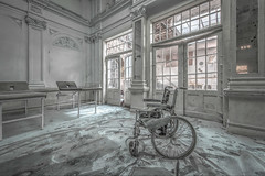 But, it is a tuned one.... (Geppestein) Tags: urbex urban exploring wheelchair wheels chair disabled recovering recovery hospital d800 nikon decay lost places abandoned