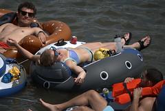 Recreational Floating (Scott 97006) Tags: float guys woman female lady water river sunshine recreation fun