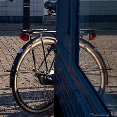 (The Joy of Now Photography) Tags: miksang miksangphotography goodeye openingthegoodeye contemplativephotography contemplative natasschadehoop reflection reflectie reflectioninwindow reflectieinwater bike fiets fietswiel bikewheel window raam straat street outdoor