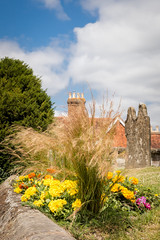 Colors (Jez22) Tags: jeremysage phot photography goudhurst kent england marigolds ornamental grasses blue cloud sky yellow colourful colors headstone wall churchyard copyright