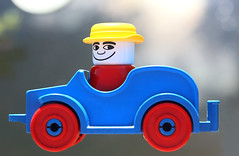 Houston, we have lift off ! (HansHolt) Tags: toy car wheels driver man hat airborn liftoff lego duplo figure plastic vintage blue red yellow backlight tabletop macro dof bokeh canon 6d 100mm canoneos6d canonef100mmf28macrousm