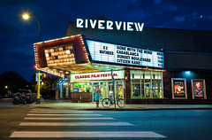 riverview theater movie cinema art deco minneapolis minnesota (Dan Anderson.) Tags: riverviewtheater cinema movie artdeco minneapolis saintpaul minnesota mn neighborhood streamlinemoderne architecture style film picture show pictureshow filmfestival classicmovies gonewiththewind casablanca sunsetboulevard citizenkane goldenage hollywood street light crossing crosswalk night girl popcorn posters marquee sign classic bike bicycle bluehour