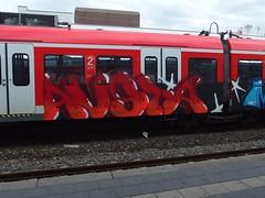 AUSTA (mkorsakov) Tags: bochum hbf bahnhof mainstation zug train sbahn s1 graffiti piece bunt colored austa rot red