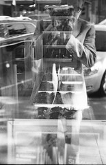 Window Shopping at the Candy Store, Frankfort Michigan (ejbarth) Tags: leicaiiif film ultrafine pushprocessing d76 selfdeveloped bw nb sw frankfort michigan summer summitar