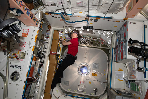 Christina Koch of NASA partially installs cables