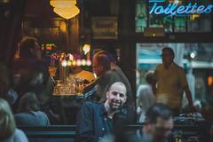 A look inside the café (Sjaco Manuputty) Tags: street streetphotography café bar pub people window reflection lights bokeh toilettes terrace antwerp antwerpen