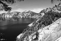 Impressions of Crater Lake: Slopes (g-liu) Tags: oregon crater lake nationalpark blackandwhite monochrome usa west sky water darktable sony a6500 july 2018 daylight daytime contrast reflection trees evergreen slopes caldera round volcano partlycloudy