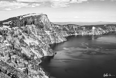 Impressions of Crater Lake: Llao Rock (g-liu) Tags: oregon crater lake nationalpark blackandwhite monochrome usa west sky water darktable sony a6500 july 2018 daylight daytime contrast reflection trees evergreen slopes caldera round rock volcano partlycloudy
