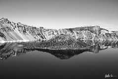 Impressions of Crater Lake: The Lone Island (g-liu) Tags: oregon crater lake nationalpark blackandwhite monochrome usa west sky water darktable sony a6500 july 2018 daylight daytime contrast reflection trees evergreen slopes caldera round island volcano partlycloudy