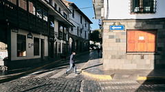 Streets of Peru (Sony J Thomas) Tags: cusco peru street morning light travel man crossing pedestrian architecture city old