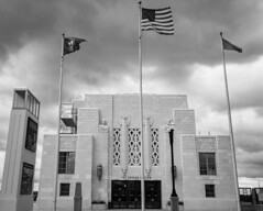 Union Station with flags and stormy skies (iMatthew) Tags: architecture ne omaha artdeco stormclouds 10thstreet stormyskies 10thstreetbridge omahaunionstation artdecoarchitecture durhammuseum