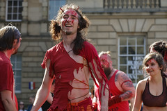 Beltane Fertility Dancing April 2019-149 (Philip Gillespie) Tags: edinburgh city urban scotland canon 5dsr beltane fire society red group dancing music drums beat rhythm pulse fertility mid summer street bodies girls boys men women legs arms faces hands feet eyes expression emotion raw photography colour color outdoor outside sky sun back light lit hair paint body markings pagan young crowd performance event people kids family art festival fringe exhibitionist display ritual drama beltain religious life