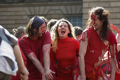 Beltane Fertility Dancing April 2019-147 (Philip Gillespie) Tags: edinburgh city urban scotland canon 5dsr beltane fire society red group dancing music drums beat rhythm pulse fertility mid summer street bodies girls boys men women legs arms faces hands feet eyes expression emotion raw photography colour color outdoor outside sky sun back light lit hair paint body markings pagan young crowd performance event people kids family art festival fringe exhibitionist display ritual drama beltain religious life