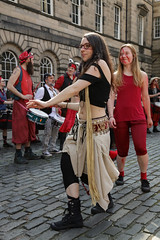Beltane Fertility Dancing April 2019-143 (Philip Gillespie) Tags: edinburgh city urban scotland canon 5dsr beltane fire society red group dancing music drums beat rhythm pulse fertility mid summer street bodies girls boys men women legs arms faces hands feet eyes expression emotion raw photography colour color outdoor outside sky sun back light lit hair paint body markings pagan young crowd performance event people kids family art festival fringe exhibitionist display ritual drama beltain religious life