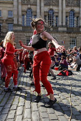 Beltane Fertility Dancing April 2019-142 (Philip Gillespie) Tags: edinburgh city urban scotland canon 5dsr beltane fire society red group dancing music drums beat rhythm pulse fertility mid summer street bodies girls boys men women legs arms faces hands feet eyes expression emotion raw photography colour color outdoor outside sky sun back light lit hair paint body markings pagan young crowd performance event people kids family art festival fringe exhibitionist display ritual drama beltain religious life