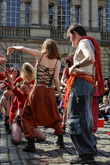 Beltane Fertility Dancing April 2019-136 (Philip Gillespie) Tags: edinburgh city urban scotland canon 5dsr beltane fire society red group dancing music drums beat rhythm pulse fertility mid summer street bodies girls boys men women legs arms faces hands feet eyes expression emotion raw photography colour color outdoor outside sky sun back light lit hair paint body markings pagan young crowd performance event people kids family art festival fringe exhibitionist display ritual drama beltain religious life