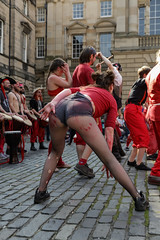 Beltane Fertility Dancing April 2019-110 (Philip Gillespie) Tags: edinburgh city urban scotland canon 5dsr beltane fire society red group dancing music drums beat rhythm pulse fertility mid summer street bodies girls boys men women legs arms faces hands feet eyes expression emotion raw photography colour color outdoor outside sky sun back light lit hair paint body markings pagan young crowd performance event people kids family art festival fringe exhibitionist display ritual drama beltain religious life