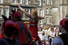 Beltane Fertility Dancing April 2019-141 (Philip Gillespie) Tags: edinburgh city urban scotland canon 5dsr beltane fire society red group dancing music drums beat rhythm pulse fertility mid summer street bodies girls boys men women legs arms faces hands feet eyes expression emotion raw photography colour color outdoor outside sky sun back light lit hair paint body markings pagan young crowd performance event people kids family art festival fringe exhibitionist display ritual drama beltain religious life