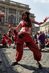 Beltane Fertility Dancing April 2019-131 (Philip Gillespie) Tags: edinburgh city urban scotland canon 5dsr beltane fire society red group dancing music drums beat rhythm pulse fertility mid summer street bodies girls boys men women legs arms faces hands feet eyes expression emotion raw photography colour color outdoor outside sky sun back light lit hair paint body markings pagan young crowd performance event people kids family art festival fringe exhibitionist display ritual drama beltain religious life