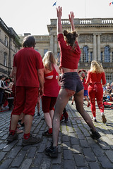 Beltane Fertility Dancing April 2019-119 (Philip Gillespie) Tags: edinburgh city urban scotland canon 5dsr beltane fire society red group dancing music drums beat rhythm pulse fertility mid summer street bodies girls boys men women legs arms faces hands feet eyes expression emotion raw photography colour color outdoor outside sky sun back light lit hair paint body markings pagan young crowd performance event people kids family art festival fringe exhibitionist display ritual drama beltain religious life