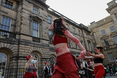 Beltane Fertility Dancing April 2019-106 (Philip Gillespie) Tags: edinburgh city urban scotland canon 5dsr beltane fire society red group dancing music drums beat rhythm pulse fertility mid summer street bodies girls boys men women legs arms faces hands feet eyes expression emotion raw photography colour color outdoor outside sky sun back light lit hair paint body markings pagan young crowd performance event people kids family art festival fringe exhibitionist display ritual drama beltain religious life